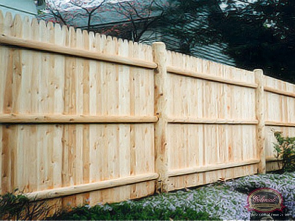 A Classic Salem Stockade Fence With Round Cedar Posts Creates Privacy Rustic Flair